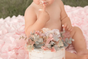 first birthday cake with flowers and pink tutu