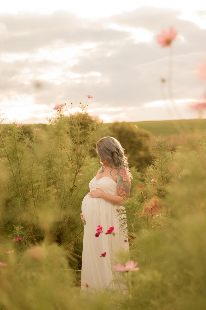 pregnant woman in field of flowers