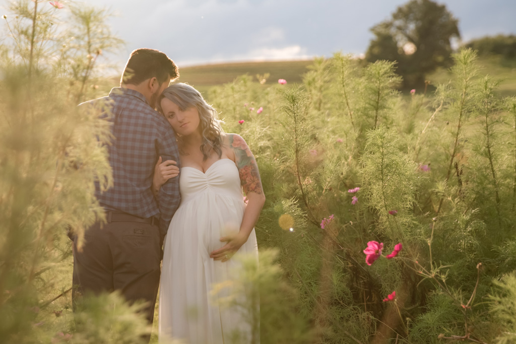 outdoor maternity session in wild flower field