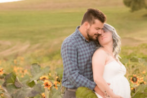 outdoor maternity session in sunflower field