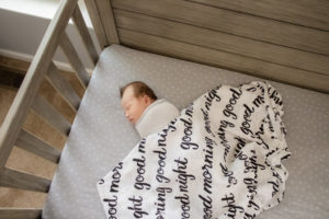 newborn baby in crib lifestyle session