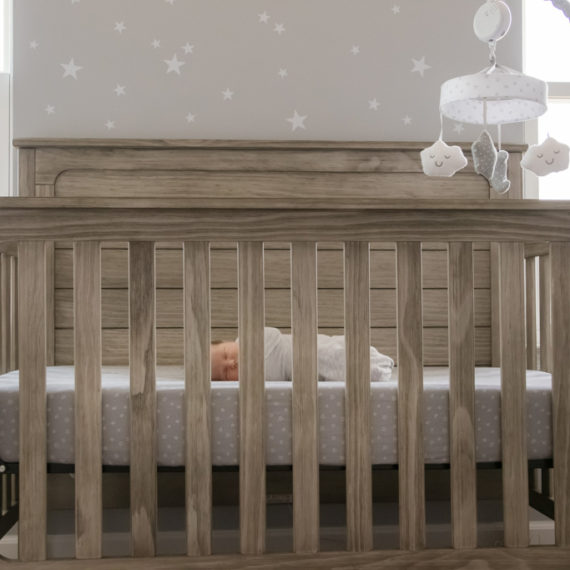 newborn baby boy in crib, lifestyle session