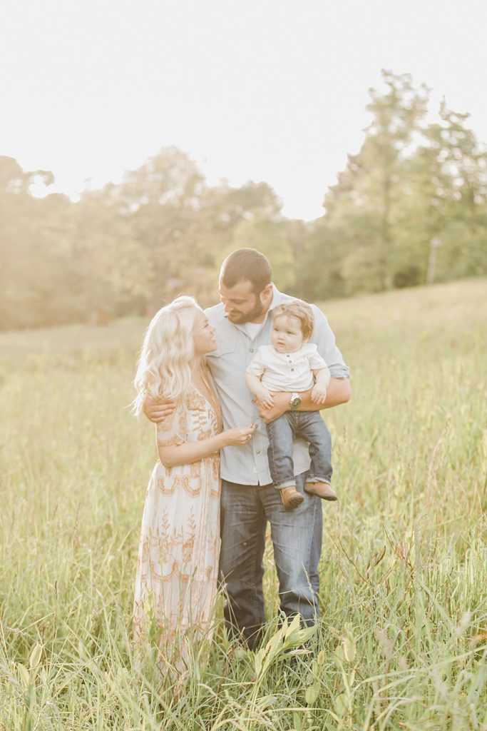 styled one year milestone photo session in tall gras field at mingo creek park