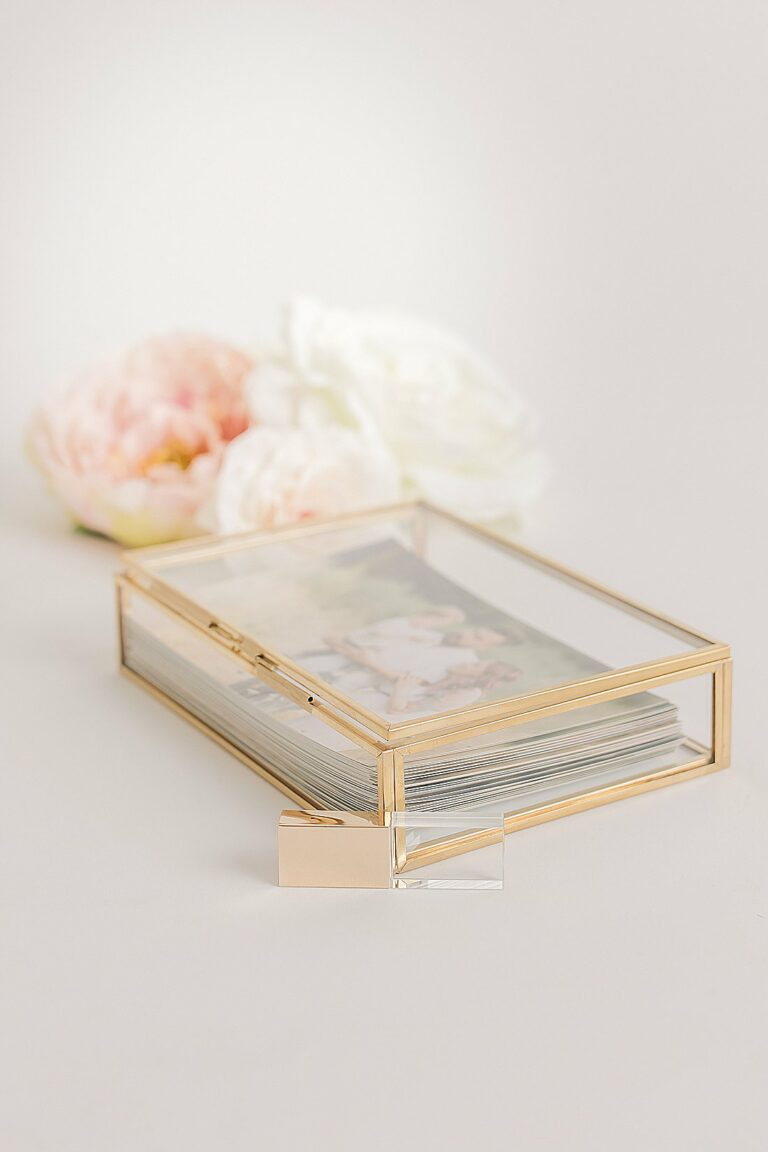 brass & glass keepsake box with 4x6 printed proofs surrounded by florals_petite magnolia photography