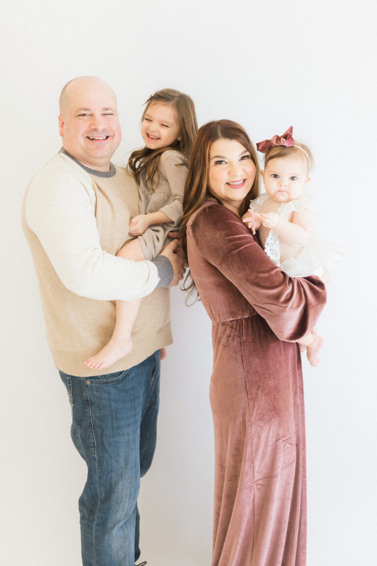 styled family in white studio - petite magnolia photography